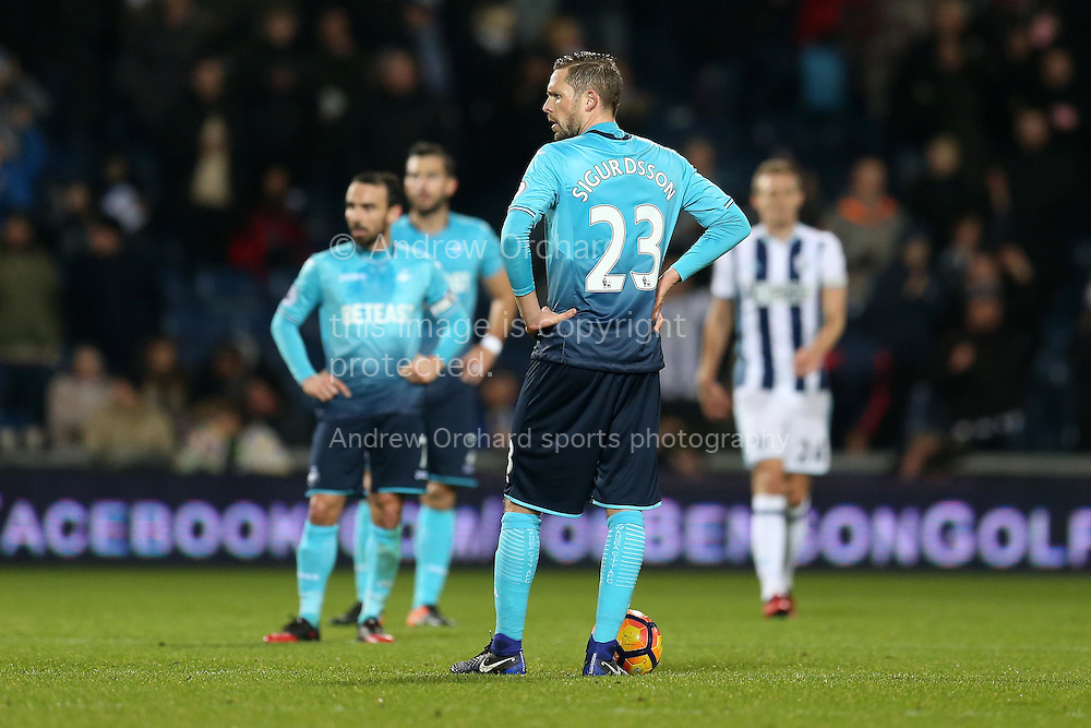 Gylfi Sigurdsson of Swansea city looks on dejected as he prepares to restart following a goal by West Bromwich Albion. Premier league match, West Bromwich Albion v Swansea city at the Hawthorns stadium in West Bromwich, Midlands on Wednesday 14th December 2016. pic by Andrew Orchard, Andrew Orchard sports photography.