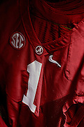 Equipment managers work in the Mal Moore Athletic Facility to get the University of Alabama football team ready for the trip to Baton Rouge to face LSU.  Dee Hart's jersey hangs in the equipment room.  cPhoto by Gary Cosby Jr.