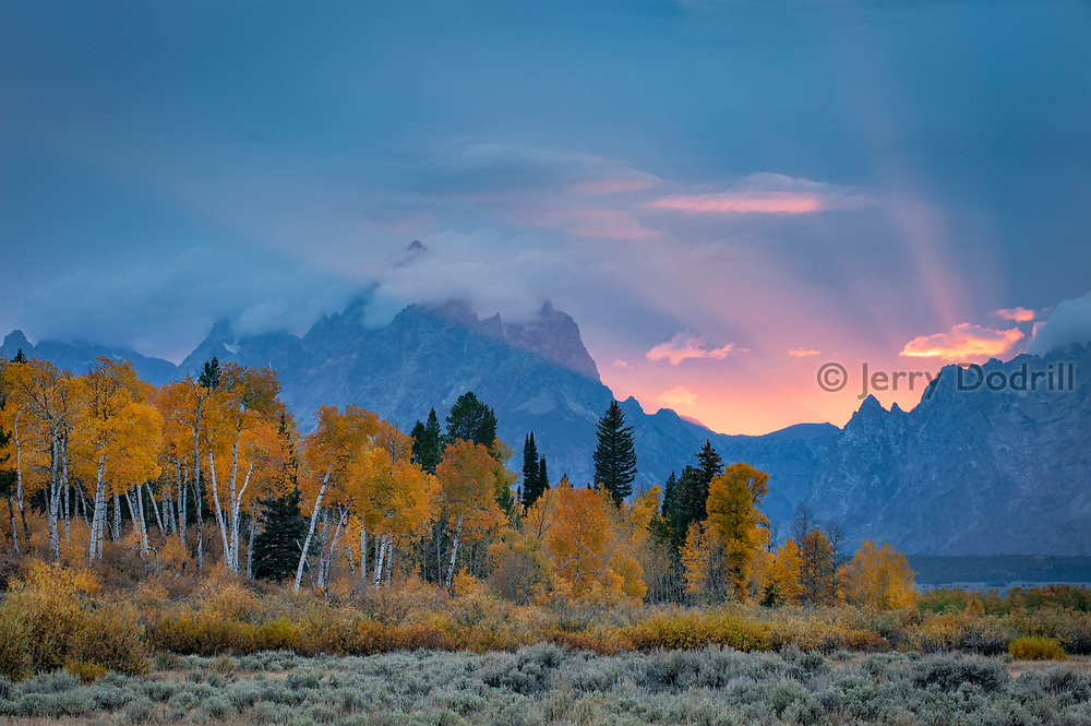 The Sun sets behind the Teton Range in Grand Teton National Park, Jackson, Wyoming