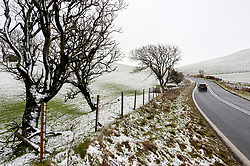 © Licensed to London News Pictures. 27/01/2019.  Llanfihangel-nant-Melan, Powys, Wales, UK. A motorist drives along the A44 road near  Llanfihangel-nant-Melan in Powys, Wales, UK. after snow fell overnight in Powys, Wales, UK. credit: Graham M. Lawrence/LNP