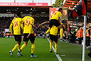 Goal - Troy Deeney (9) of Watford celebrates after he scores a goal to give a 0-2 lead with Craig Dawson (4) of Watford leaping on his back during the Premier League match between Bournemouth and Watford at the Vitality Stadium, Bournemouth, England on 12 January 2020.