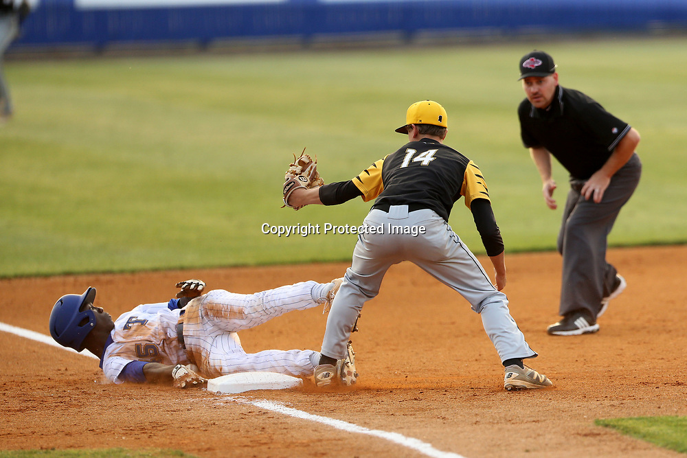 Tupelo's Nick Ratliff look back at the umpire after being tagged out by Hernando's Hunter Ray in the first inning. The call was reversed due to a dropped ball and Ratlif was safe.