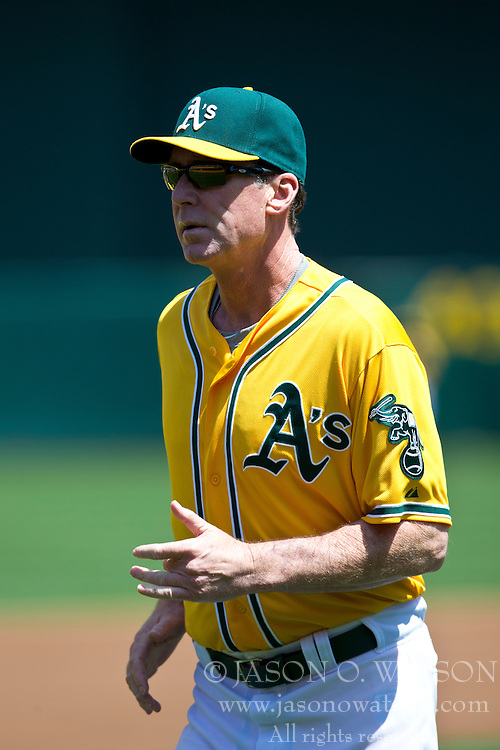 OAKLAND, CA - APRIL 27: Bob Melvin #6 of the Oakland Athletics returns to the dugout during the first inning against the Baltimore Orioles at O.co Coliseum on April 27, 2013 in Oakland, California. The Baltimore Orioles defeated the Oakland Athletics 7-3. (Photo by Jason O. Watson/Getty Images) *** Local Caption *** Bob Melvin