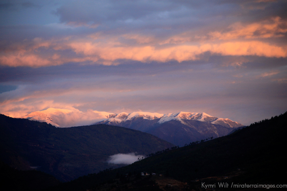 Asia, Bhutan, Paro. Snow capped peaks and pink clouds welcome morning's arrival in the Paro Valley.