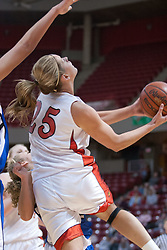 26 February 2006:  Holly Hallstrom twists to take a reverse as she comes out from under the bucket.....Illinois State Redbirds out muscled the Creighton Bluejays on Senior day by a score of 75-61.  Senior Holly Hallstorm grabbed her 10th double double with 20 points and 12 rebounds.  Competition took place at Redbird Arena on Illinois State University campus in Normal Illinois.