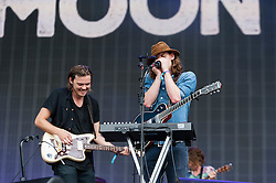 © Licensed to London News Pictures. 12/07/2014. London, UK.   Half Moon Run performing live at Hyde Park as part of the British Summer Time series of outdoor concerts.   In this picture - Devon Portielje (left), Conner Molander (right). Half Moon Run are a Canadian indie rock band  consisting of members Devon Portielje (vocals/guitar), Dylan Phillips (vocals/drums), Conner Molander (guitar/keyboard/vocals), and Isaac Symonds (vocals/percussion/mandolin/keyboard/guitar).  Photo credit : Richard Isaac/LNP