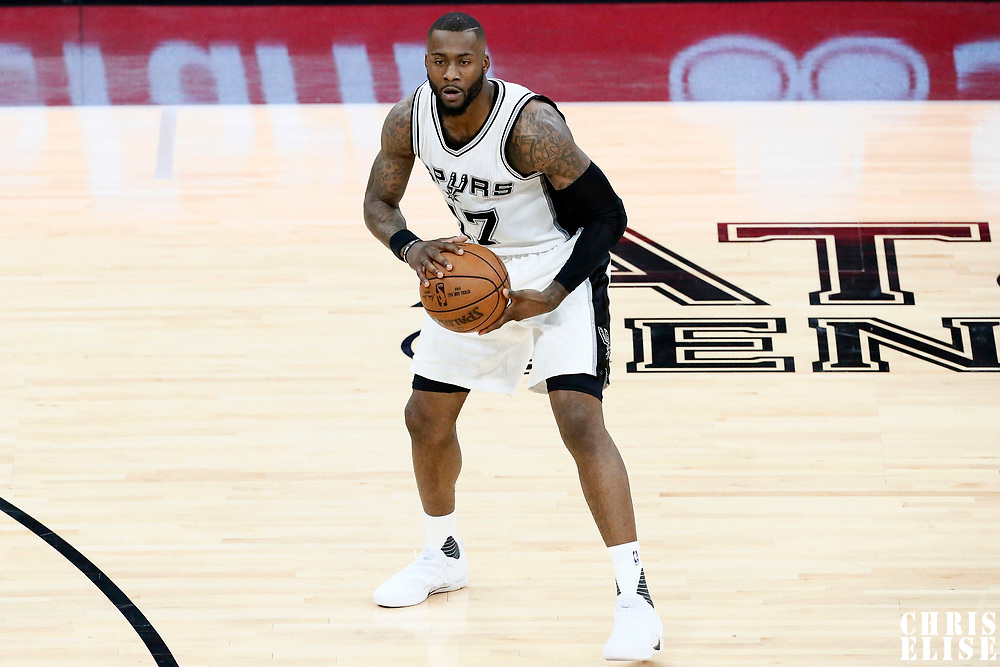 03 May 2017: San Antonio Spurs guard Jonathon Simmons (17) passes the ball during the San Antonio Spurs 121-96 victory over the Houston Rockets, in game 2 of the Western Conference Semi Finals, at the AT&T Center, San Antonio, Texas, USA.