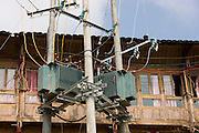 Telegraph pole with telephone and power lines installed in the mountain village of Ping An, Longsheng, near Guilin, China
