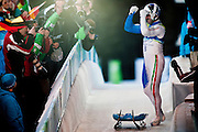 Armin Zoeggeler, ITA, celebrates after finishing his fourth run of the Men's Single Luge competition during the 2010 Vancouver Winter Olympics at the Whistler Sliding Centre in Whistler, British Columbia, Sunday, Feb. 14, 2010. Zoeggeler finished in third place earning him the bronze metal.