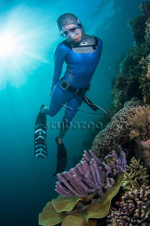 Free diver, Ai Futaki, swimming above coral reef, Sipadan, Sabah, Malaysia