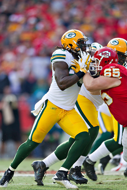 KANSAS CITY, MO - DECEMBER 18:   Erik Walden #93 of the Green Bay Packers is blocked by Ryan Lilja #65 of the Kansas City Chiefs at Arrowhead Stadium on December 18, 2011 in Kansas CIty, Missouri.  The Chiefs defeated the Packers 19-14.   (Photo by Wesley Hitt/Getty Images) *** Local Caption *** Erik Walden; Ryan Lilja