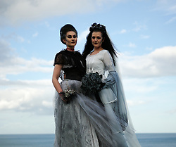 © Licensed to London News Pictures. <br /> 01/11/2014. <br /> <br /> Whitby, Yorkshire, United Kingdom<br /> <br /> Ruby Moreton (L), 21 and Victoria Morris, 29, from Rotherham attend the Whitby Goth Weekend. <br /> <br /> The event this weekend brings together thousands of extravagantly dressed followers of Victoriana, Steampunk, Cybergoth and Romanticism who all visit the town to take part in celebrating Gothic culture. This weekend marks the 20th anniversary since the event was started by local woman Jo Hampshire.<br /> <br /> Photo credit : Ian Forsyth/LNP
