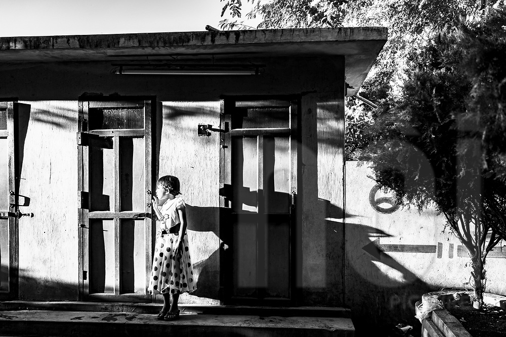 Portrait of a young Burmese girl outside her dwelling, Bagan, Myanmar, Asia