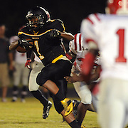 Topsail's Tyrekus Cooper rushes against Jacksonville.