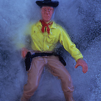 Plastic model of cowboy in ice drawing his gun
