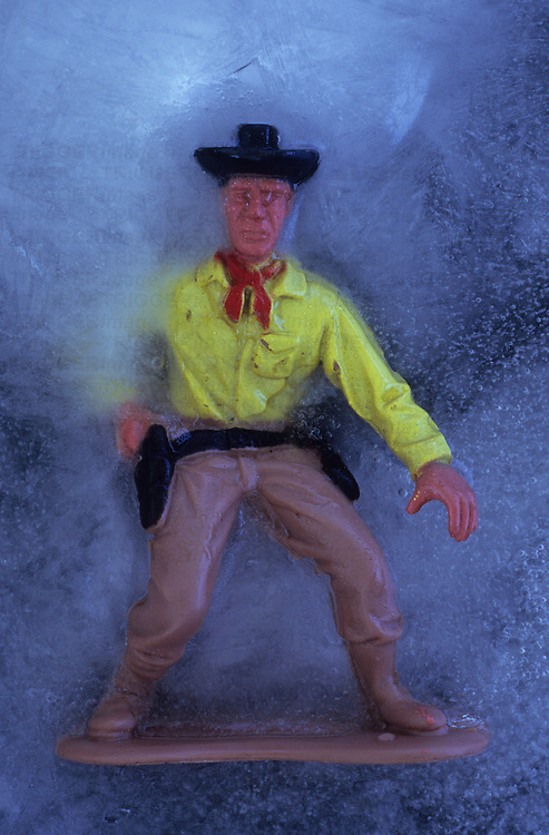 Plastic model of cowboy in ice drawing his gun