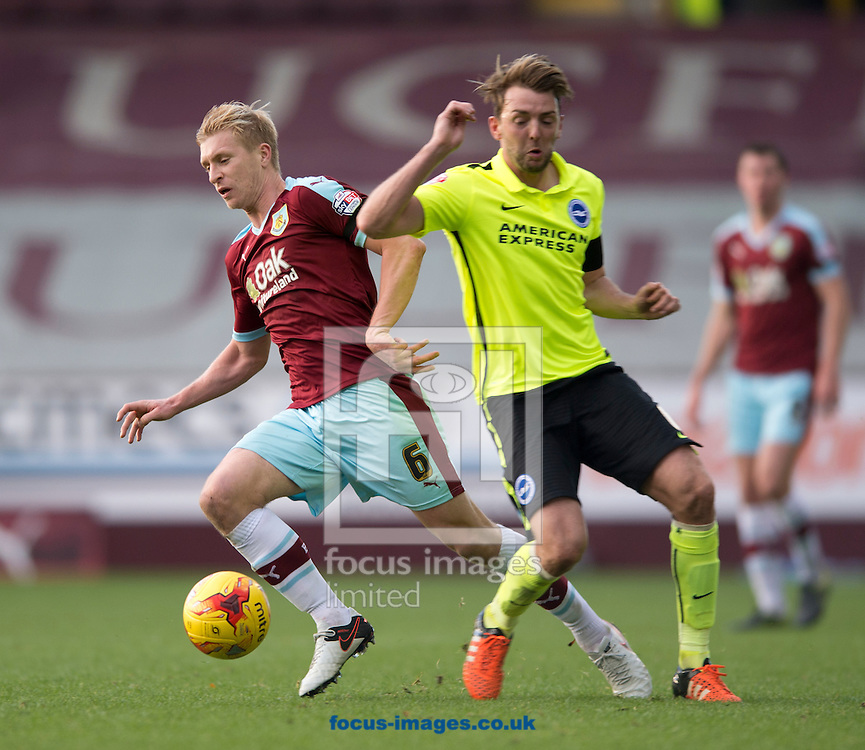Ben Mee of Burnley (left) turns inside Dale Stephens of Brighton and Hove Albion (centre) during the Sky Bet Championship match at Turf Moor, Burnley<br /> Picture by Russell Hart/Focus Images Ltd 07791 688 420<br /> 22/11/2015