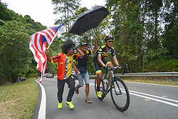 March 24, 2018 - Malaysian supporters run with Muhammad Shaiful Adlan Mohd Shukri from Malaysian National Team during the seventh stage, the 222.4 km from Nilai to Muar, of the 2018 Le Tour de Langkawi. On Saturday, March 24, 2018, in Muar, Malaysia. (Credit Image: © Artur Widak/NurPhoto via ZUMA Press)