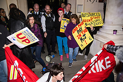 London, UK. 12th February, 2019. A member of grassroots trade union United Voices of the World is pushed to the ground whilst protesting outside the Gadson Club in Pall Mall on the occasion of a reception with Justice Secretary David Gauke against his refusal to negotiate with the trade union over their demands for the London Living Wage, annual leave and sick pay for outsourced cleaners, security guards and receptionists working at the Ministry of Justice, all of whom have been on strike for varying periods recently. The Gadson Club is the official alumni club for the Oxford University Conservative Association.