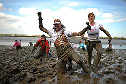 © London News Pictures. 05/05/2013. Maldon, UK. Competitors take part in the Maldon Mud Race in Maldon, Essex on May 05, 2013. The race originated in 1973 and involves competitors racing around a course on the mudbanks of the river Blackwater at low tide. Photo credit: Ben Cawthra/LNP.