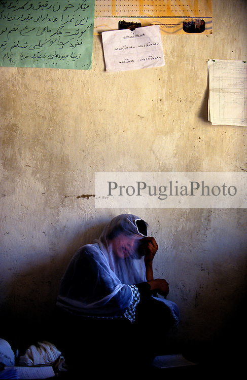 YAFTAL PAYAN, 31 July 2005..A young lady at Bitha Bala's Vocational Traning Centre.....The VTC aim is to make women aware of their onwn status as Mother and as Woman, by giving lessons on maternity, reproductive health, family planning and post-natal issues.....According to United Nations Population Fund, Afghanistan has among the world?s highest rates of maternal mortality, and Badakhshan has the highest rates ever recorded anywhere in the world, with one mother dying in every 15 births. Underage marriage is one of the primary causes of maternal mortality.....The VTC is funded by UNFPA and implemented by IBNSINA.