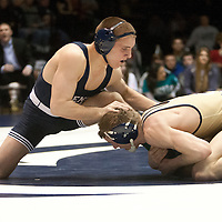 February 23, 2014; State College, PA, USA;  Clarion's Tyler Bedelyon gains control of the ankle of Penn State's Zain Retherford in their 141-pound match at Rec Hall. Penn State defeated Clarion 43-3.