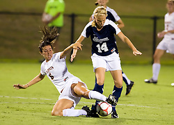 Virginia Cavaliers defender/midfielder Katie Carr (6) tackles Georgetown Hoyas midfielder Samantha Baker (14).  The #6 Virginia Cavaliers played the Georgetown Hoyas to a 2-2 draw in a NCAA Women's Soccer pre-season exhibition game held at Klockner Stadium on the Grounds of the University of Virginia in Charlottesville, VA on August 18, 2008.
