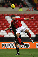 Photo: Pete Lorence.<br />Nottingham Forest v Bentford. Coca Cola League 1. 04/11/2006.<br />Nicky Southall leaps over Charlie Ide.