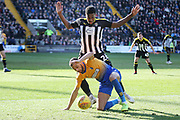 Mansfield Town midfielder CJ Hamilton ann Notts County midfielder Mitch Rose (26) during the EFL Sky Bet League 2 match between Notts County and Mansfield Town at Meadow Lane, Nottingham, England on 16 February 2019.
