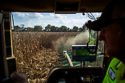 Tim Hully harvests corn at Walnut Grove Farm in Adairville, Ky. (The New York Times)