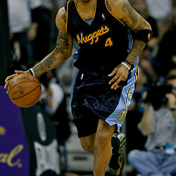 Dec 18, 2009; New Orleans, LA, USA;  Denver Nuggets forward Kenyon Martin (4) controls the ball against the New Orleans Hornets during the second half at the New Orleans Arena. The Hornets defeated the Nuggets 98-92. Mandatory Credit: Derick E. Hingle-US PRESSWIRE