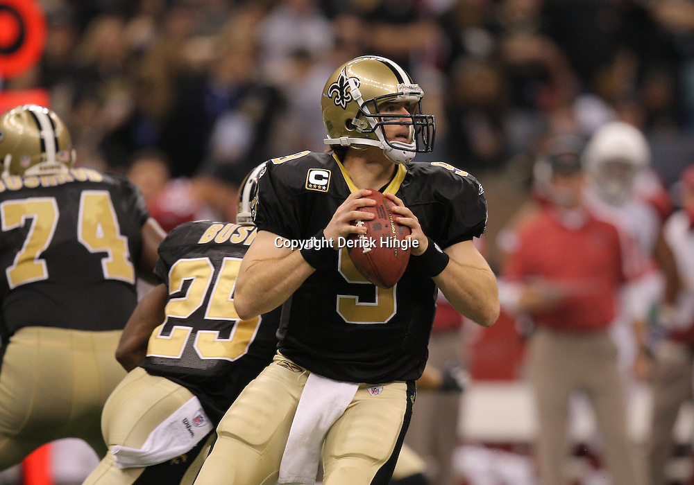 16 January 2010:  New Orleans Saints quarterback Drew Brees (9) throws a pass during a 45-14 win by the New Orleans Saints over the Arizona Cardinals in a 2010 NFC Divisional Playoff game at the Louisiana Superdome in New Orleans, Louisiana.