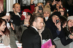 © Licensed to London News Pictures. David Beckham signs autographs as he attends The Class of 92  World Film Premiere at The Odeon West End, Leicester Square, London on 01 December 2013. Photo credit: Richard Goldschmidt/LNP