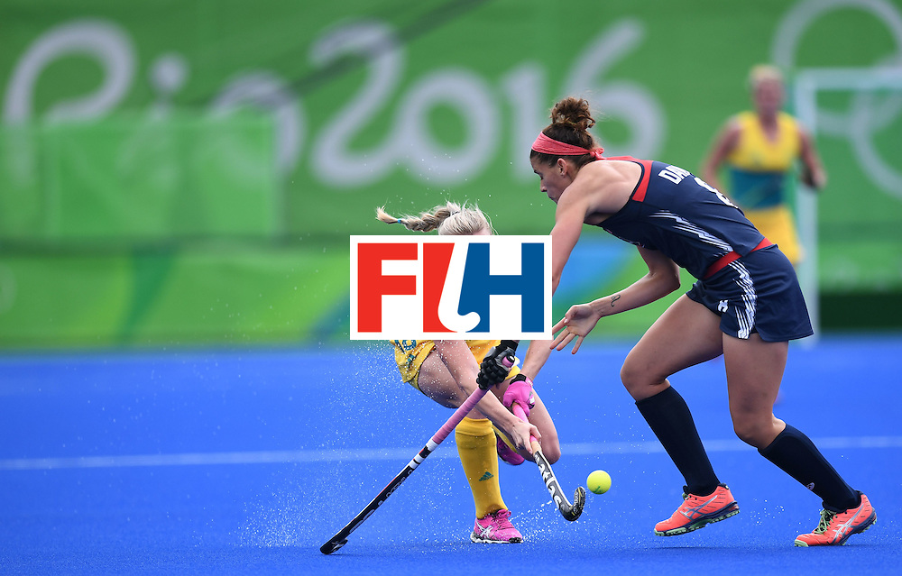 Australia's Jane-Anne Claxton (L) fights for the ball with the USA's Rachel Dawson during the womens's field hockey Australia vs USA match of the Rio 2016 Olympics Games at the Olympic Hockey Centre in Rio de Janeiro on August, 8 2016. / AFP / MANAN VATSYAYANA        (Photo credit should read MANAN VATSYAYANA/AFP/Getty Images)