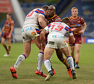 Michael Lawrence of Huddersfield Giants is tackled by Keegan Hirst (L) & Tyler Randall (R) of Wakefield Trinity during the Betfred Super League match at the John Smiths Stadium, Huddersfield<br /> Picture by Richard Land/Focus Images Ltd +44 7713 507003<br /> 27/07/2018