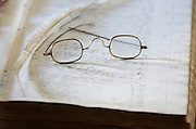 Antique eyeglasses on Federal-era account books, Woodlawn Museum, Ellsworth, Maine.