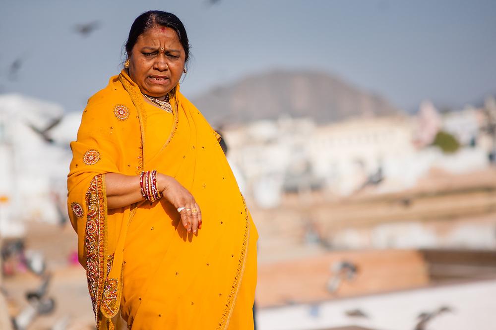 Indian woman in orange sari in Pushkar (India)