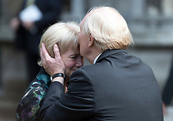 © Licensed to London News Pictures. 20/06/2016. London, UK. NEIL KINNOCK kisses his wife GLENYS KINNOCK on the forehead as they leave St Margaret's Church, Westminster Abbey after taking part in a Service of Prayer and Remembrance to commemorate Jo Cox MP, who was killed in her constituency on June 16, 2016. Photo credit: Peter Macdiarmid/LNP