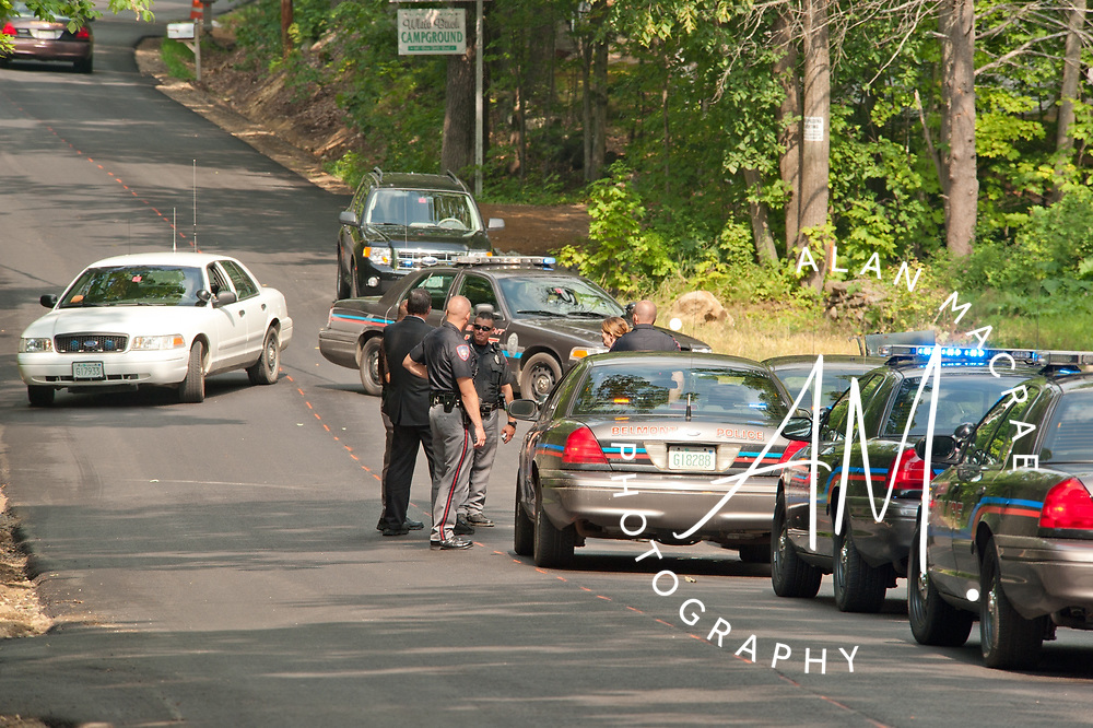 A mass of police officers descended on a residence on Bean Hill Road in Belmont to arrest a subject involved in a Laconia shooting Wednesday morning.  {Alan MacRae/for the Citizen)