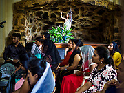 08 OCTOBER 2017 - KATUNAYAKE, WESTERN PROVINCE, SRI LANKA: People at Catholic mass in Katunayake, a community north of Colombo. About 8% of Sri Lanka is Christian, the majority of which are Roman Catholic. Catholicism was spread by Portuguese colonizers who came to Sri Lanka in the 1500 and 1600s.    PHOTO BY JACK KURTZ