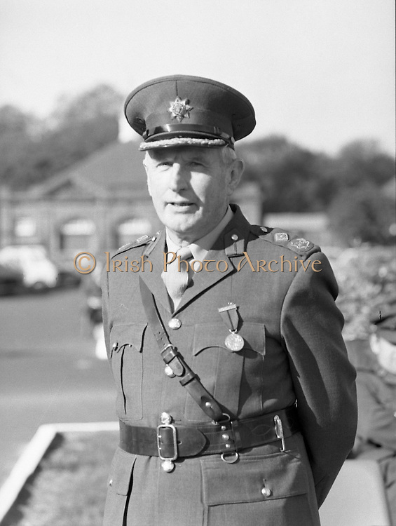 50th Infantry Batallion Depart for Lebanon.   (N97)..1981..15.10.1981..10.15.1981..15th October 1981..Before departure to Lebanon, the 50th Infantry Batallion was inspected by An Taoiseach, Dr Garret Fitzgerald, he was accompanied by the Minister for Defence, Mr James Tully TD...Picture shows Maj-General James Quinn former G.O.C UNIFIL, wearing the Distinguished Service Medal which was presented to him by Mr James Tully TD, Minister for Defence prior to the review of the troops.