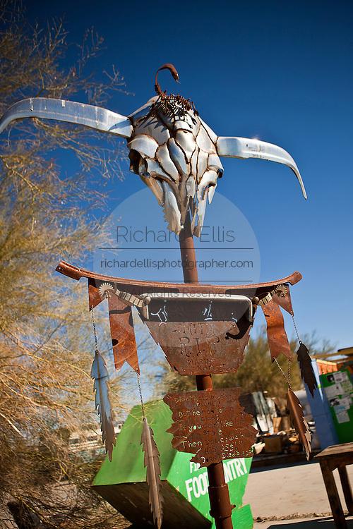 Metal cattle skull decorates public space in the Slab City commune camp Niland, California