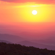 The sun rises over Shenandoah National Park, as seen from the Mt. Marshall Overlook along Skyline Drive.