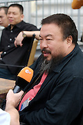 documenta12. Official photo op of documenta staff and artists at Fridericianum..Ai Weiwei giving interviews.