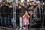 Frankfurt | 18 March 2017<br /> <br /> Am Samstag (18.02.2017) feierten &uuml;ber 30000 Kurden im Rahmen einer Demonstration das kurdische Neujahrsfest Newroz, bei der Demo sprachen sie sich gegen eine Diktatur und f&uuml;r die Freilassung von PKK-F&uuml;hrer Abdullah &Ouml;calan aus.<br /> Hier: Die Kundgebung nach der Demo findet im Europaviertel statt, ein kleines M&auml;dchen in rosa Kleidung inmitten von Demonstranten hinter einem Absperrgitter.<br /> <br /> photo &copy; peter-juelich.com<br /> <br /> Nutzung honorarpflichtig!