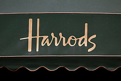 © Licensed to London News Pictures. 26/12/2013. London, UK. The world famous Harrods logo is seen on an awning on the department store as it begins it's Boxing Day sale in London today (26/12/2013). Photo credit: Matt Cetti-Roberts/LNP