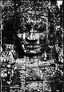 Face on gate to Ankor Thom. There are five entrances (gates) to the city. Each gate is crowned with 4 giant faces.