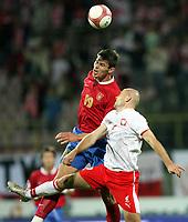 Fotball<br /> EM-kvalifisering<br /> 06.09.2006<br /> Polen v Serbia<br /> Foto: Wrofoto/Digitalsport<br /> NORWAY ONLY<br /> <br /> MARIUSZ JOP /R/ OF POLAND AND NIKOLA ZIGIC /L/ OF SERBIA