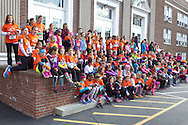 "Cornwall-on-Hudson, New York - Girls in the Girls on the Run Hudson Valley program and their adult ""running buddies"" line up for a group photograph before racing 3.1 miles at the Cornwall Lions Club Fall Harvest Race 5K on Nov. 10, 2013. Girls on the Run is a national program with a mission of helping girls to be joyful, healthy and confident using an experience-based curriculum which creatively integrates running."