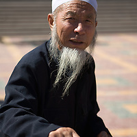 Chinese muslims standup outside of the  Dujia Tan Mosque after one of the five daily prays,  in northwest China's Ningxia Hui Autonomous Region, China, on Thursday, September. 11, 2008. The islam is the second biggest religion in China, where there are between 20 and 30 millions of muslims.
